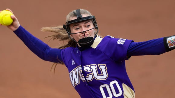 Western Carolina player Savannah Rice pitches during an NCAA softball game against Boston College on Friday, February 28, 2020, in Athens, Ga. (AP Photo/John Amis)