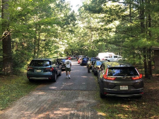 """Cars pile up, blocking entrances to employee housing, campground and picnic area in Cades Cove on a """"vehicle-free"""" day in Great Smoky Mountains National Park. The park closed March 24. On March 25, an employee who worked in Cades Cove tested positive for the coronavirus."""
