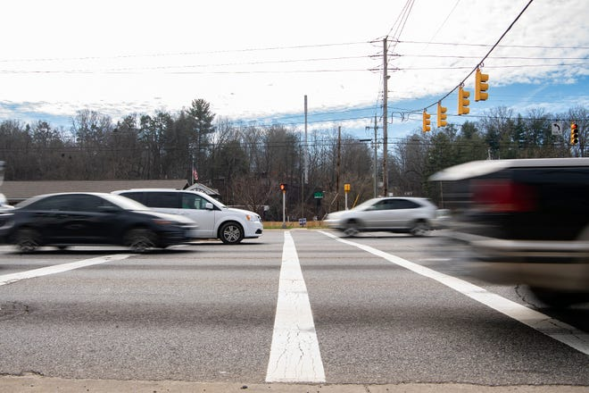 A van waits to turn left as the light turns green and cars begin to move on Patton Avenue at Louisiana Avenue on Feb. 17, 2020. The intersection is one of the most dangerous for car wrecks and pedestrians in Asheville.