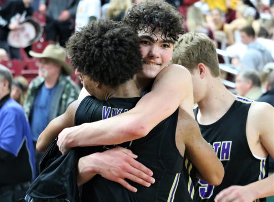 North Kitsap's Jonas La Tour receives a hug from teammate Kobe McMillian after La Tour's 26-point performance in Thursday's 64-43 win over White River in the Class 2A state quarterfinals. The Vikings play in the semifinals Friday.