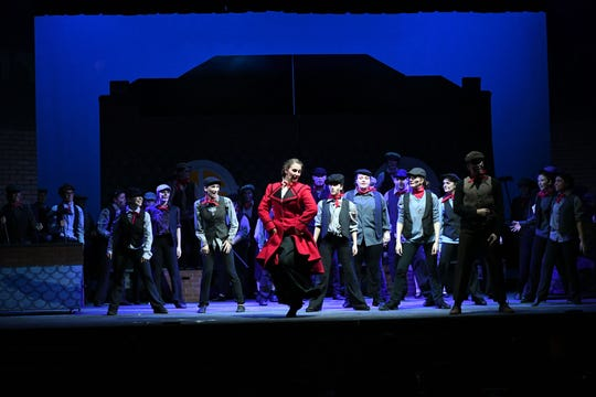 Members of the ensemble cast for Camden Catholic's spring musical Mary Poppins at a recent dress rehearsal. Camden Catholic's spring musicals date back to 1922.
