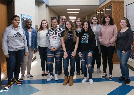 The Ohio University Chillicothe mentors pose with the mentees in the hallway of Chillicothe High School on March 4, 2020.