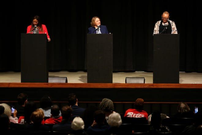 From left: Hamilton County commission candidates Alicia Reece, Connie Pillich and Kelli Prather debate, Thursday, March 5, 2020, at Kresge Auditorium at the University of Cincinnati in Cincinnati.