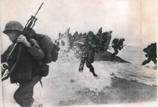 Marines leave a landing craft and come ashore at Da Nang Bay in South Vietnam in 1965.