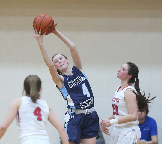 Cincinnati Country Day's Sarah Zimmerman (4) grabs a rebound during their regional semifinal win over New Madison Tri-Village, Thursday, March 5, 2020.
