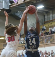 Cincinnati Country Day's Kamryn Jordan (24) drives to the basket against Tri-Village player Lissa Siler(30) during their regional semifinal win, Thursday, March  5, 2020.
