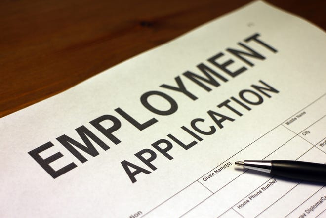 Someone filling out Employment Application Form