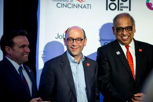 Mayor John Cranley, Cincinnati Children's Hospital Medical Center's president and CEO Michael Fisher and University of Cincinnati president Neville Pinto talk after a press conference to announce a $100 million investment in University of Cincinnati and Cincinnati Children's Hospital Medical Center at a press conference on Friday, March 6, 2020 University of Cincinnati's 1819 Innovation Hub. JobsOhio estimates the plan will add $3 billion annually to the local economy and 20,000 high-skilled jobs over 10 years.