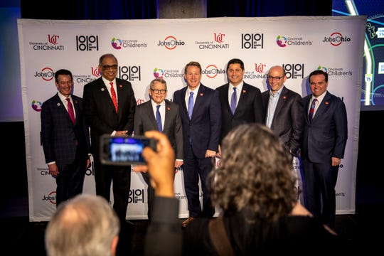 University of Cincinnati chief innovation officer David J. Adams, University of Cincinnati President Neville Pinto, Ohio Gov. Mike DeWine, Ohio Lt. Gov. Jon Husted, JobsOhio president and chief investment officer J.P. Nauseef, Cincinnati Children's Hospital Medical Center's president and CEO Michael Fisher and Mayor John Cranley stand together for photos after a press conference to announce a $100 million investment in University of Cincinnati and Cincinnati Children's Hospital Medical Center at a press conference on Friday, March 6, 2020 University of Cincinnati's 1819 Innovation Hub.