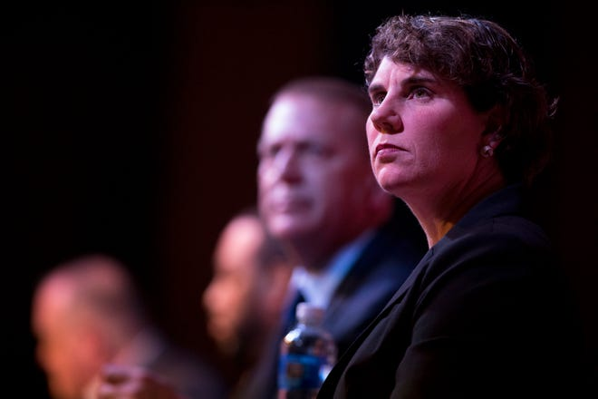 Amy McGrath, former Marine, looks on while sitting with other candidates during the Democratic U.S. Senate Candidate primary forum at Southgate House Revival in Newport, Ky., on Thursday, March 5, 2020.