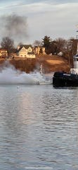 A man was rescued by Perth Amboy firefighters Thursday from a burning board not from from the city's marina.