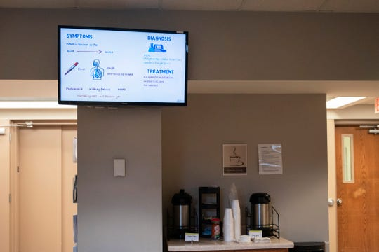 """A waiting room monitor displays symptoms of coronavirus on Mar. 6, 2020 at Broadlawns Medical Center in Des Moines. """"The vast majority of people who get this new coronavirus are just going to have cold symptoms,"""" said physician Jason Kruse. According to Kruse, the few who become very sick are ones contracting respiratory illness, which is believed to cause a majority of COVID-19 mortalities."""