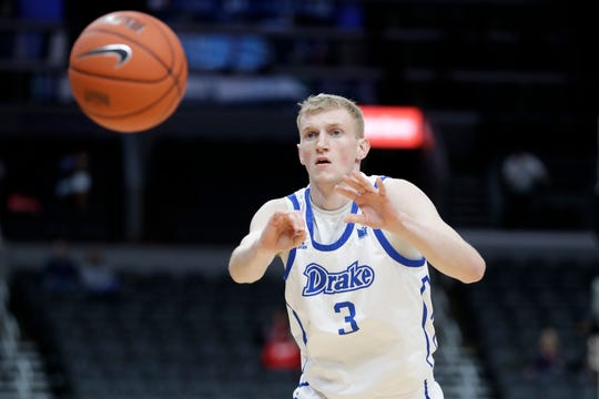 Drake's Garrett Sturtz passes during the first half of an NCAA college basketball game against Illinois State in the first round of the Missouri Valley Conference men's tournament Thursday, March 5, 2020, in St. Louis.