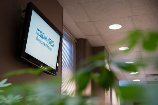"A waiting room monitor displays symptoms of coronavirus on Mar. 6, 2020 at Broadlawns Medical Center in Des Moines. ""The vast majority of people who get this new coronavirus are just going to have cold symptoms,"" said physician Jason Kruse. According to Kruse, the few who become very sick are ones contracting respiratory illness, which is believed to cause a majority of COVID-19 mortalities."