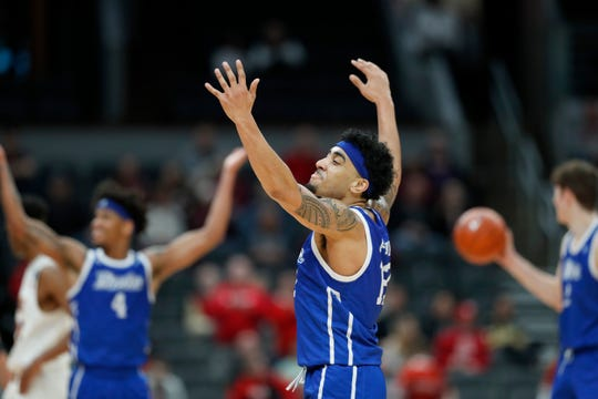 Drake's Roman Penn celebrates in the final seconds during the second half of an NCAA college basketball game against Northern Iowa in the quarterfinal round of the Missouri Valley Conference men's tournament Friday, March 6, 2020, in St. Louis.