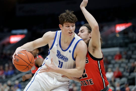 Drake's Liam Robbins, left, heads to the basket as Illinois State's Matt Chastain defends during the first half of an NCAA college basketball game in the first round of the Missouri Valley Conference men's tournament Thursday, March 5, 2020, in St. Louis.