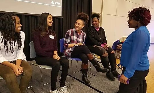"""Students attend the 2018 """"Many Shades Of Colour"""" young women's conference at Drake University."""