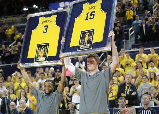 Michigan seniors guard Zavier Simpson (3) and center Jon Teske (15) were recognized before action against Nebraska, Thursday, March 5, 2020 at the Crisler Center in Ann Arbor.