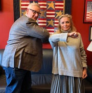 U.S. Rep. Debbie Dingell, D-Dearborn, elbow bumps with U.S. Rep. Paul Mitchell, R-Dryden to help promote germ awareness during the coronavirus outbreak.