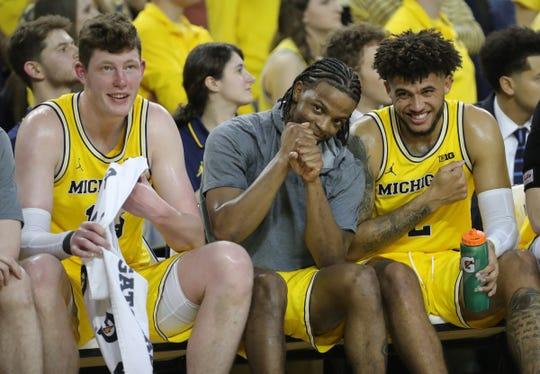 Jon Teske, left,  Zavier Simpson, center, and Isaiah Livers, right, during the final minutes of Michigan's 82-58 win over Nebraska, Thursday, March 5, 2020 at the Crisler Center in Ann Arbor.