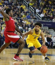Michigan guard David DeJulius drives against Nebraska forward Kevin Cross during the second half Thursday, March 5, 2020 at the Crisler Center in Ann Arbor.