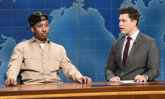"""Pictured: (l-r) Chris Redd and anchor Colin Jost during Weekend Update on  NBC's """"Saturday Night Live"""" on Feb. 29, 2020."""