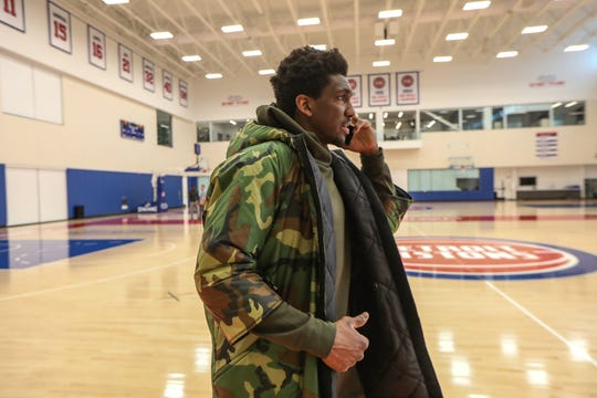 Detroit Pistons' Guard Langston Galloway, throws on his custom winter coat made for him by the Empowerment Plan,  a local non-profit that employs women from shelters to make winter coats that also serve as sleeping bags for the homeless, after finishing practice at the Detroit Pistons Performance Center in New Center Detroit on Thursday, March 5, 2020. Each coat made for a Pistons' player is matched with a coat donation, made by the Empowerment Plan, for the homeless.