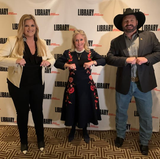 U.S. Rep. Debbie Dingell, D-Dearborn, bumps elbows with country stars Trisha Yearwood, left, and Yearwood's husband, Garth Brooks.