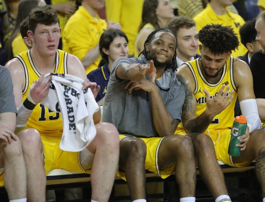 Jon Teske, left,  Zavier Simpson, center, and Isaiah Livers, right, during the final minutes of Michigan's 82-58 win over Nebraska, Thursday, March 5, 2020 at the Crisler Center in Ann Arbor.