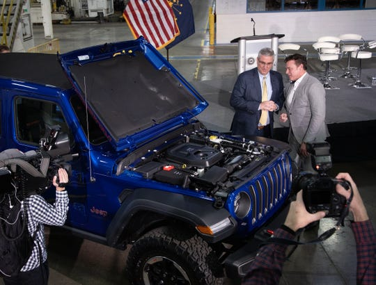 Fiat Chrysler North America COO Mark Stewart, right, and Indiana Governor Eric Holcomb with a Jeep Wrangler equipped with the 2.0-liter engine that will be built at the new Kokomo Engine Plant beginning in the second quarter of 2021.