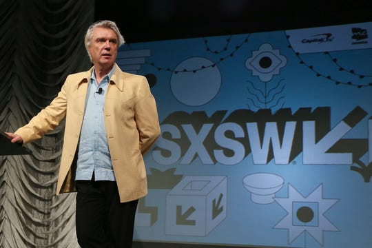 "FILE - In this March 13, 2019 file photo, David Byrne takes part in the ""Reasons To Be Cheerful"" featured session during the South by Southwest Music Festival in Austin, Texas."