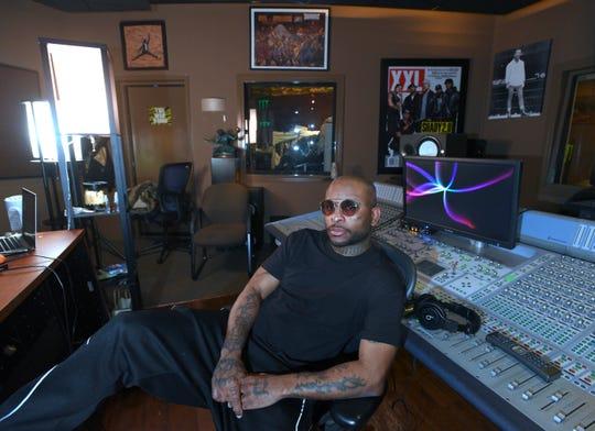 "'Royce da 5'9"" poses in his recording studio."