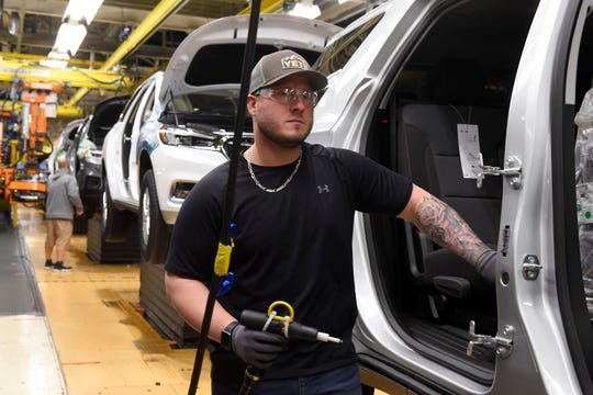 Brock Teelander works on the assembly line at the GM Lansing Delta Township plant. The real impact of the coronavirus outbreak in China soon could be felt as delays from the shipment of parts catch up to automakers.