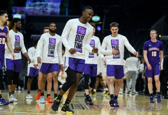 Evansville's Jawaun Newton (3) and his teammates walk to their bench before taking on the No. 7 Valparaiso Crusaders in the Missouri Valley Conference Tournament  at the Enterprise Center in St. Louis, Ill., Thursday, March 5, 2020.