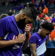 Evansville's K.J. Riley (33) and Shamar Givance (5) wipe their eyes as they walk off the court following a tough loss to the Valparaiso Crusaders in the Missouri Valley Conference Tournament at the Enterprise Center in St. Louis, Ill., Thursday, March 5, 2020. The Purple Ace fell 58-55 to the Crusaders.