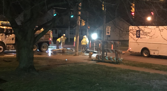 Crews work on a water main leak at the corner of Walnut and Governor Streets near downtown Evansville Thursday night.