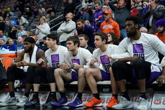The Evansville Purple Aces bench anxiously watches Evansville's K.J. Riley (33) shoot free throws with less than a minute left in the Missouri Valley Conference Tournament matchup against the Valparaiso Crusaders at the Enterprise Center in St. Louis, Ill., Thursday, March 5, 2020. The Purple Ace fell 58-55 to the Crusaders.