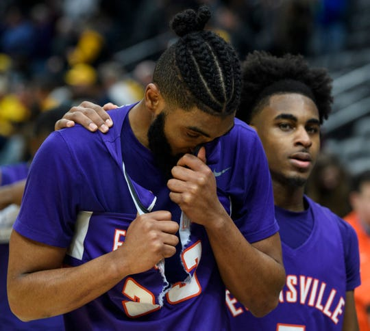 Evansville's K.J. Riley (33) reacts to a tough loss to the Valparaiso Crusaders as Evansville's Shamar Givance (5) embraces him during the Missouri Valley Conference Tournament at the Enterprise Center in St. Louis, Ill., Thursday, March 5, 2020. Riley missed a free-throw that would have tied up the game with less than a minute left.