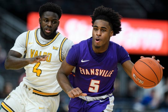 Evansville's Shamar Givance (5) drives past Valparaiso's Daniel Sackey (4) during the second half of tthe Missouri Valley Conference Tournament at the Enterprise Center in St. Louis, Ill., Thursday, March 5, 2020. The Purple Ace fell 58-55 to the Crusaders.
