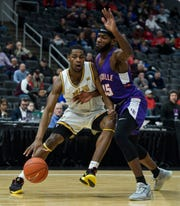 Valparaiso's Zion Morgan (2) drives around Evansville's John Hall (35) during the first round game of the Missouri Valley Conference Tournament at the Enterprise Center in St. Louis, Ill., Thursday, March 5, 2020. The Purple Ace fell 58-55 to the Crusaders.