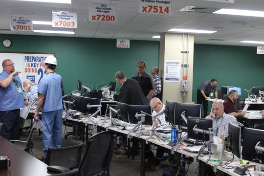 Davis-Besse Nuclear Power Station's Outage Control Center was bustling with activity Wednesday, as the plant continued with its scheduled refueling and maintenance outage. More than 1,000 contractors come in to help Davis-Besse's regular employees with the outage.