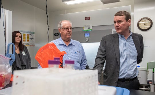 Senator Michael Bennet, right, tours the biocontainment lab with Robert Ellis, the Colorado State University Biosafety Director, at the Colorado State University Infectious Disease Research Lab in Fort Collins, Colo. on Friday, March 6, 2020. Scientists are currently working on a coronavirus vaccine at the CSU Infectious Disease Research Center.