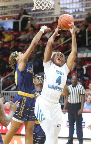 FSW's Shekinah Guthrie hauls in a rebound against Gulf Coast State during their NJCAA District VIII women's quarterfinal basketball game played Thursday at Northwest Florida State College in Niceville.