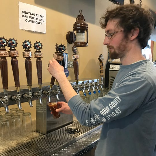 Brewmaster Nate Denzin pours a glass of Shipwrecked Brew Pub's Rowboat Roggenbock, which uses rye to balance the maltiness of a traditional bock beer.