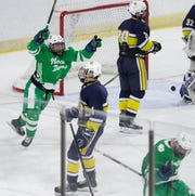 Green Bay Notre Dame's Callan Budinger (19) celebrates after a Tritons goal against University School of Milwaukee during a WIAA Division 1 state semifinal Friday at Alliant Energy Center in Madison.