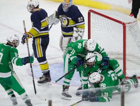 Green Bay Notre Dame players celebrate after Charlie Wied's (5) goal against University School of Milwaukee during a WIAA Division 1 state semifinal Friday at Alliant Energy Center in Madison.