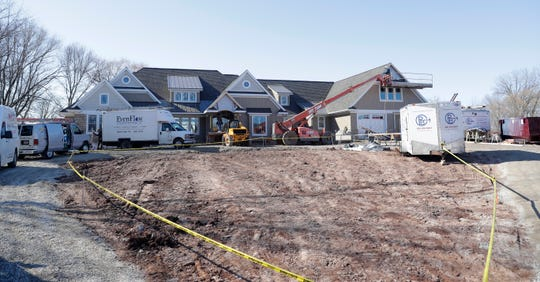 """Crews continue work to complete the construction of a five-bedroom house on Nicolet Drive in Green Bay that is wheelchair accessible and includes """"universal design"""" amenities.."""