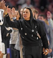 South Carolina head coach Dawn Staley works from the bench. South Carolina plays Georgia as the SEC Women's Basketball Tournament continues at Bon Secours Wellness Arena in Greenville Friday, March 6, 2020.GWINN DAVIS / MEDIA