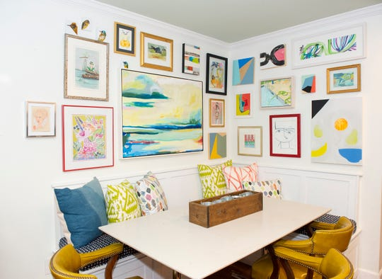 A collection of art hangs on the wall in a seating area of Everett King Waldrep's home.