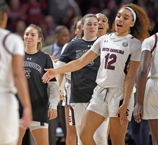 South Carolina's Brea Beal (12)  and teammates rally. South Carolina plays Georgia as the SEC Women's Basketball Tournament continues at Bon Secours Wellness Arena in Greenville Friday, March 6, 2020.GWINN DAVIS / MEDIA